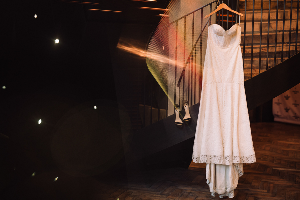williamsburg hotel wedding shoot bride's gown hanging on railing