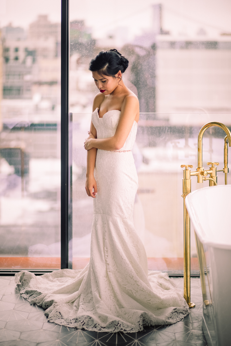 williamsburg hotel wedding shoot bride posing in front of window in gown