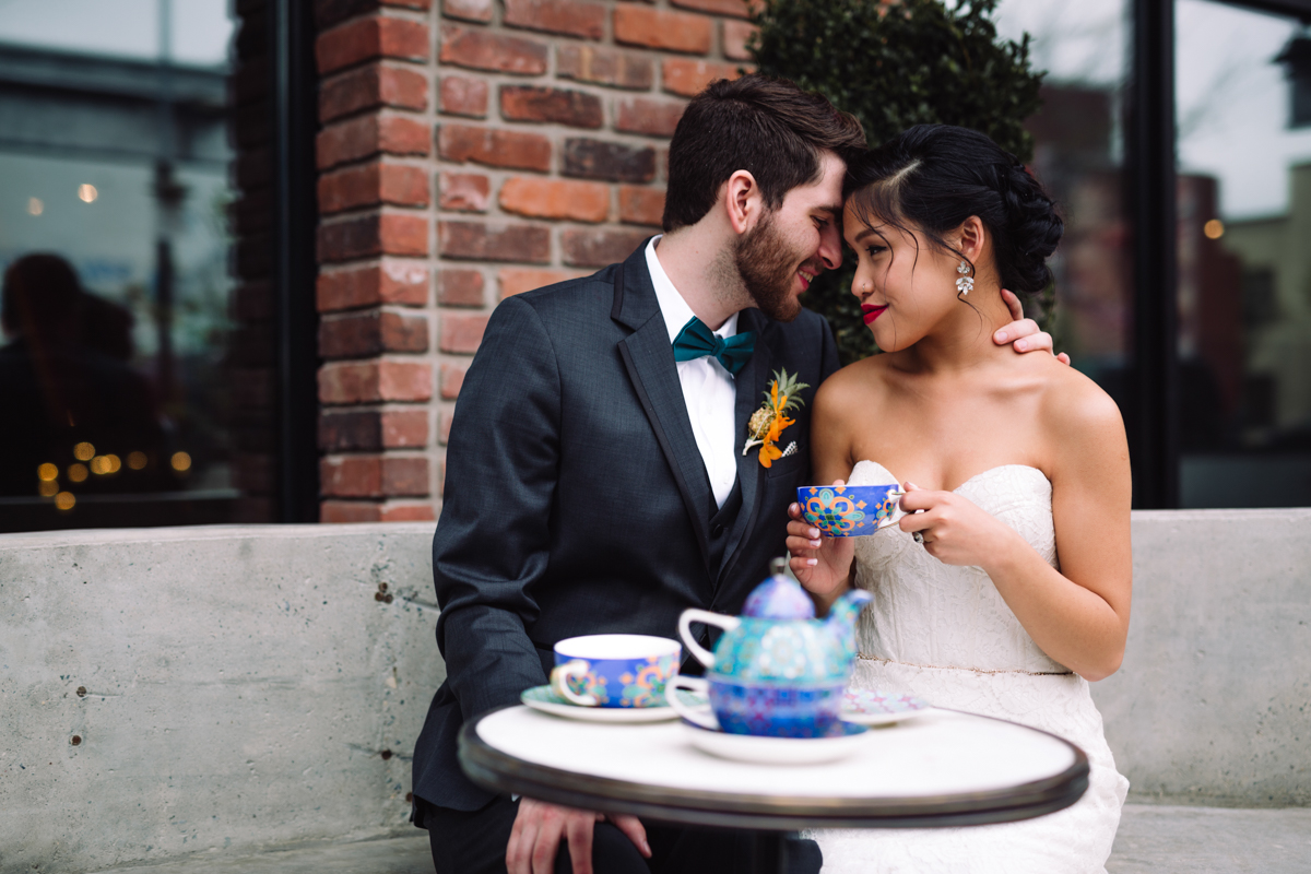 williamsburg hotel wedding shoot couple at outside table having tea