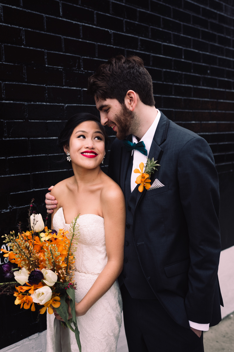 williamsburg hotel wedding shoot couple in front of dark brick