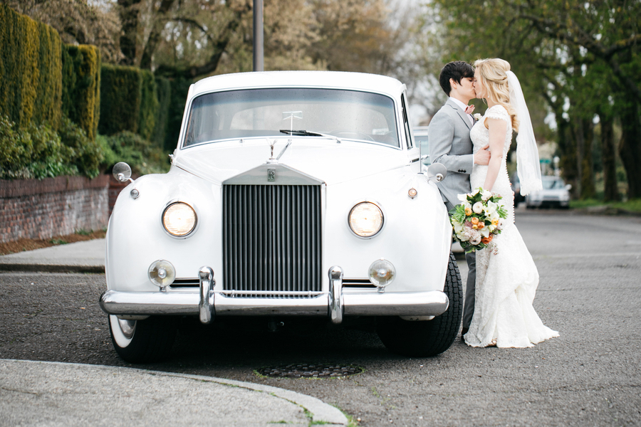 ARIN AND KATIE DOWNTOWN SEATTLE WEDDING KISS BESIDE CAR