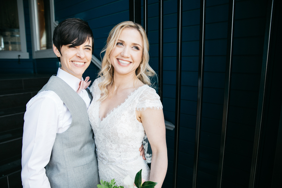 ARIN AND KATIE DOWNTOWN SEATTLE WEDDING COUPLE SMILING