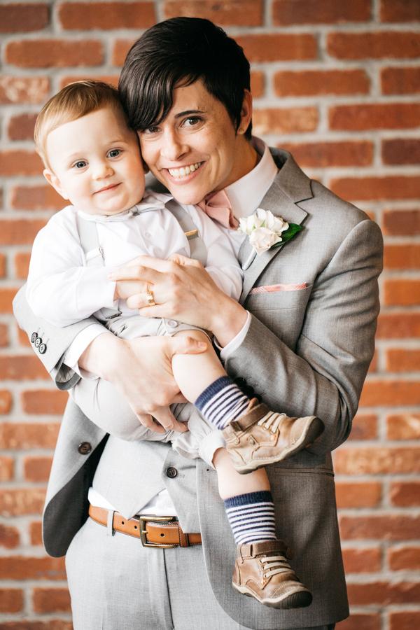 ARIN AND KATIE DOWNTOWN SEATTLE WEDDING arin holding little boy