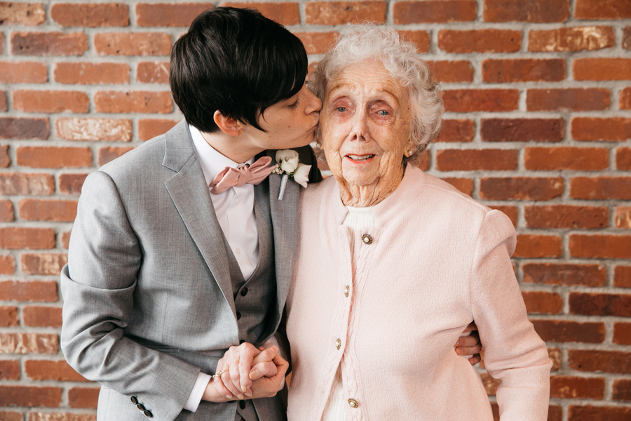ARIN AND KATIE DOWNTOWN SEATTLE WEDDING arin kissing grandmother's cheek