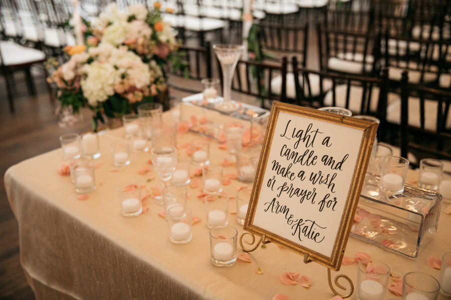 """ARIN AND KATIE DOWNTOWN SEATTLE WEDDING table of tea lights and sign reading """"light a candle and make a wish or prayer for arin & katie"""""""