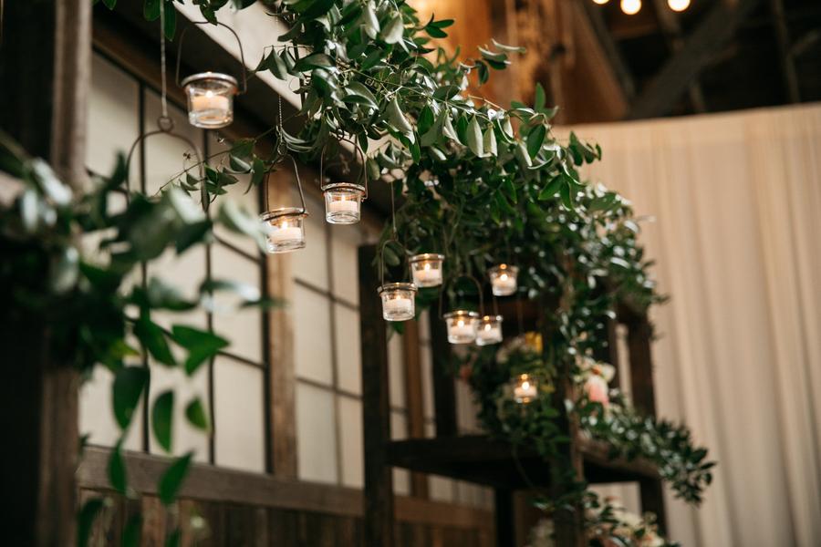 ARIN AND KATIE DOWNTOWN SEATTLE WEDDING tea lights hanging from eaves