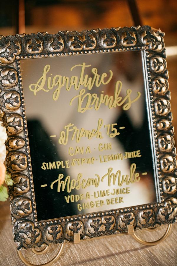ARIN AND KATIE DOWNTOWN SEATTLE WEDDING list of signature drinks written on mirror
