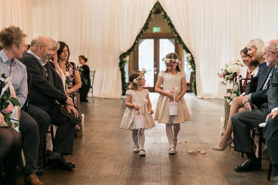 ARIN AND KATIE DOWNTOWN SEATTLE WEDDING flower girls proceeding down aisle