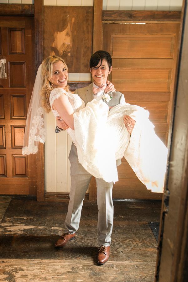 ARIN AND KATIE DOWNTOWN SEATTLE WEDDING arin holding katie
