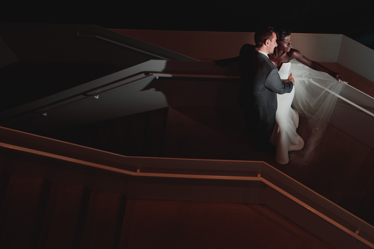 Glam cleveland museum wedding embrace on museum stairs