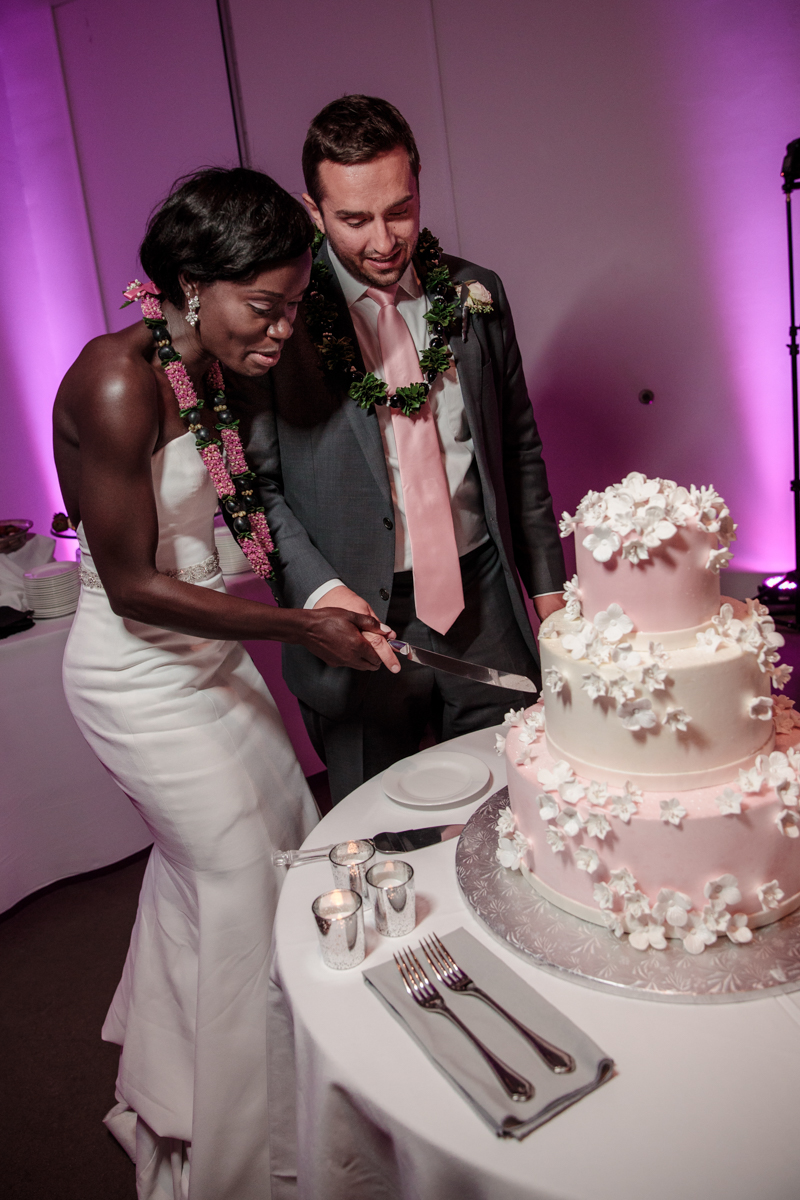 Glam cleveland museum wedding cutting cake