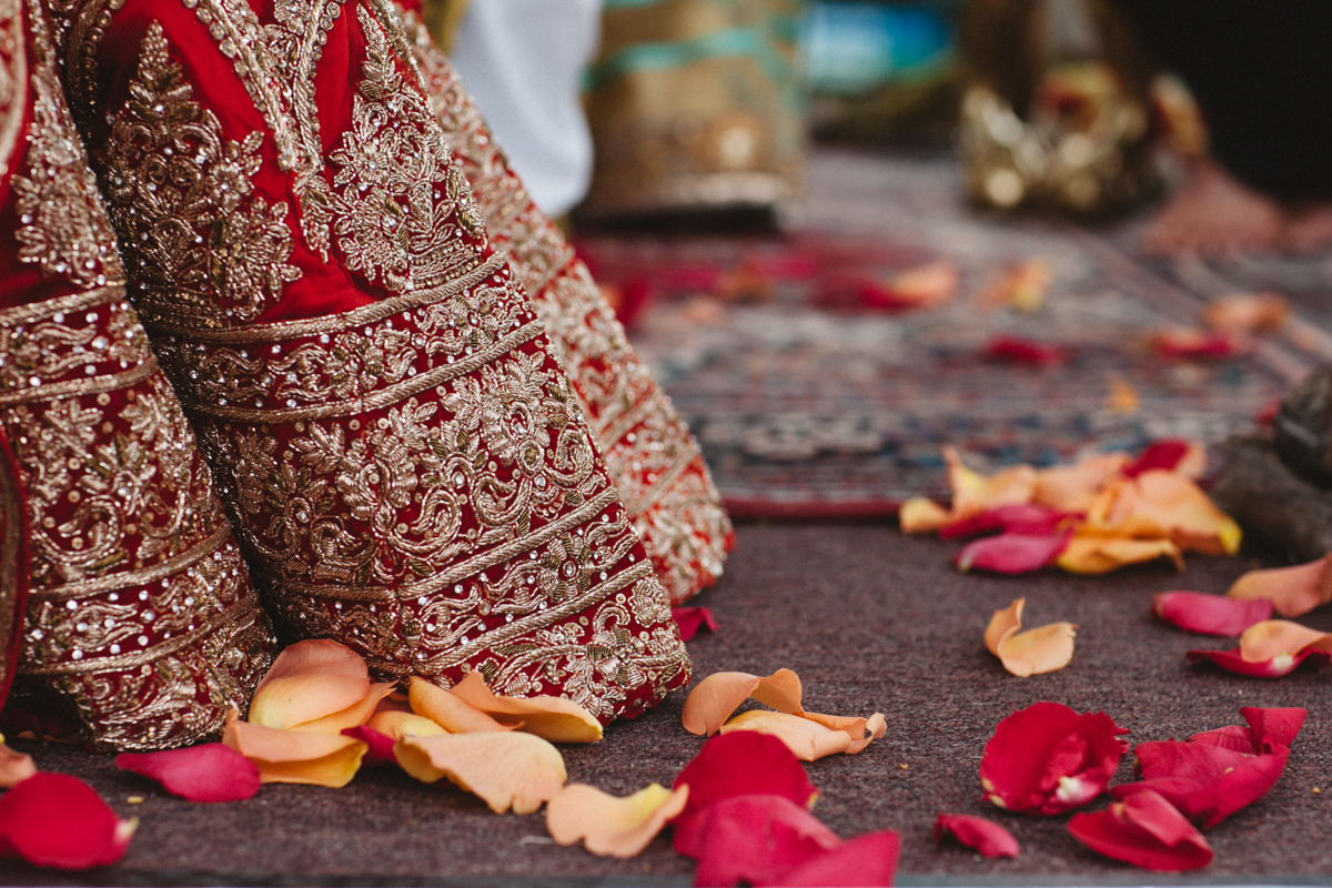 Denver Same-Sex Indian Wedding flower petals on ground with hem of albertine's dress