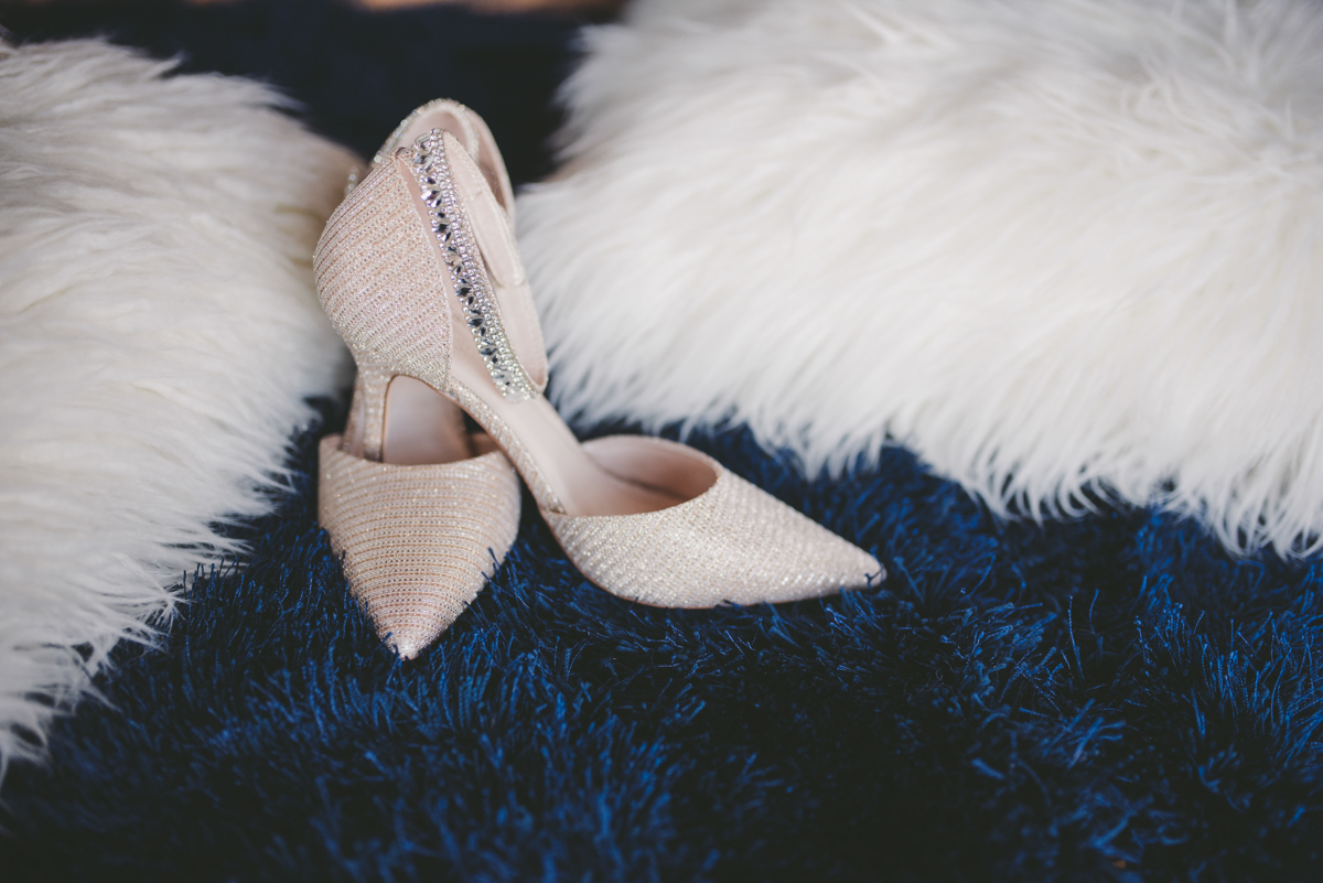 we are young worth the wait studios bride's shoes on fuzzy carpet