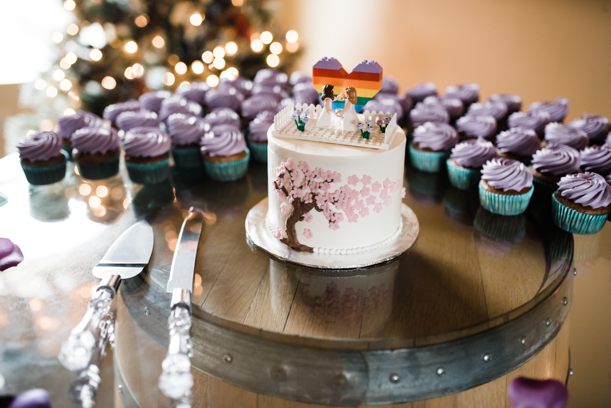 Rustic italian wedding cake with lego cake topper; cupcakes