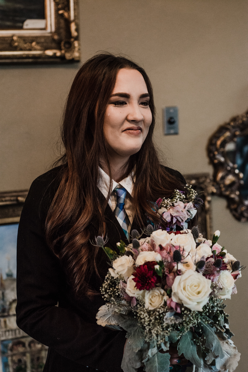 Rustic italian wedding jess holding bouquet