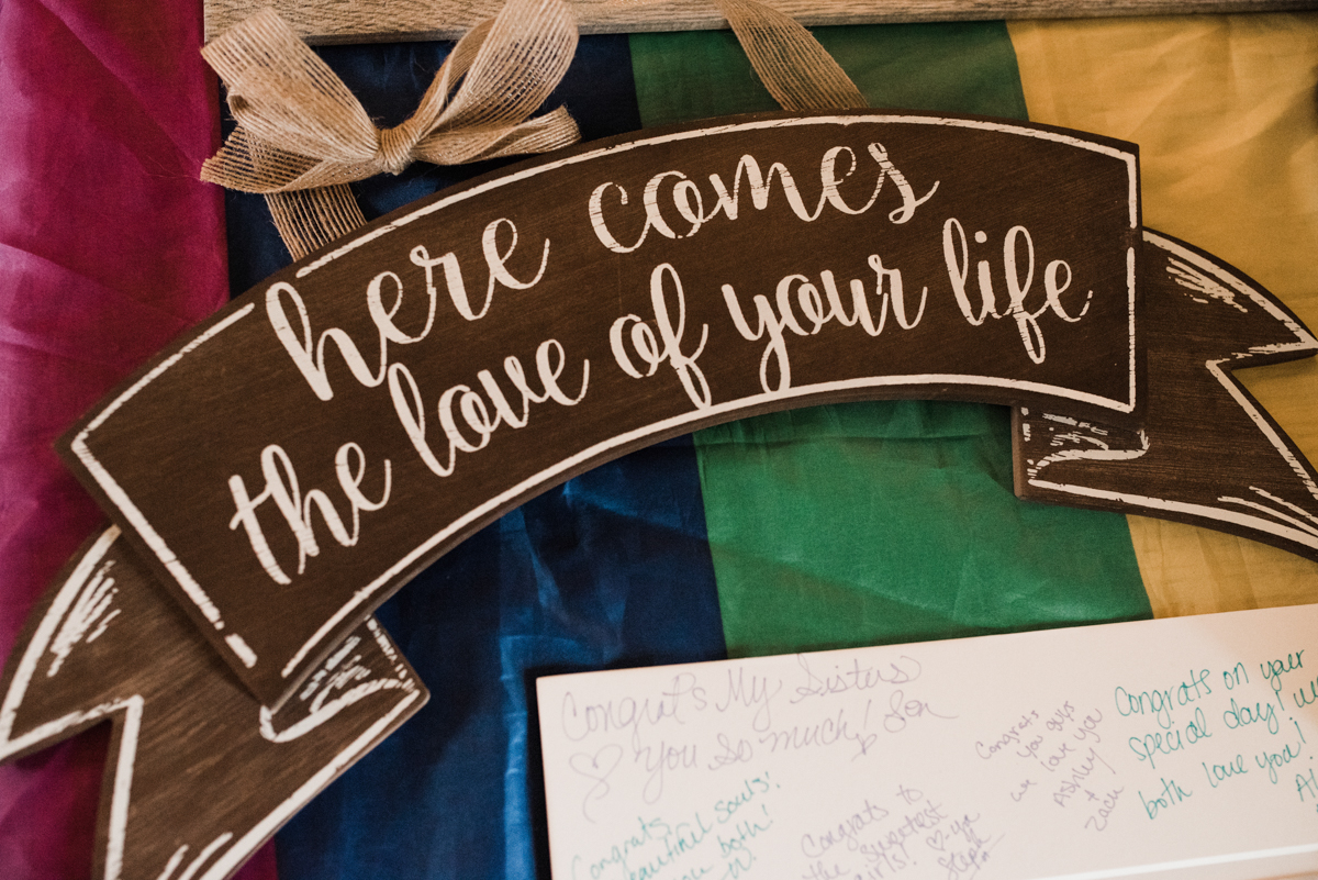"Rustic italian wedding wooden sign reading ""here comes the love of your life"""
