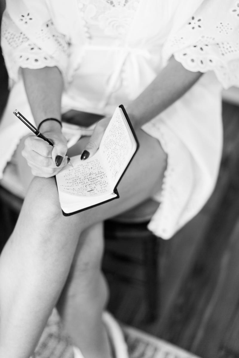Saint augustine wedding allie writing in notebook