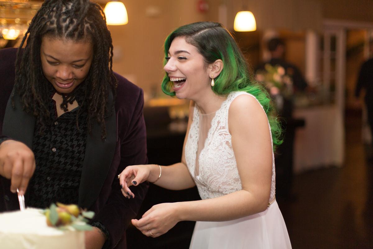 Saint augustine wedding cutting cake, allie laughing