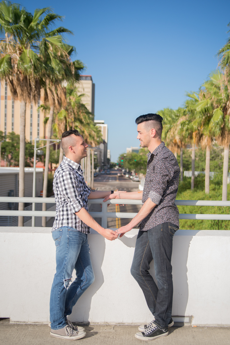 DOWNTOWN TAMPA ENGAGEMENT COUPLE HOLDING HANDS ON BRIDGE
