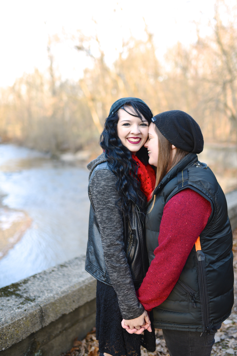 lafayette indiana engagement session couple on bridge above river holding hands