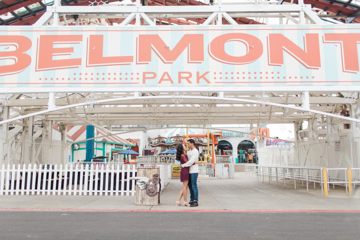 belmont park engagement session san diego angela and jamie under belmont park sign