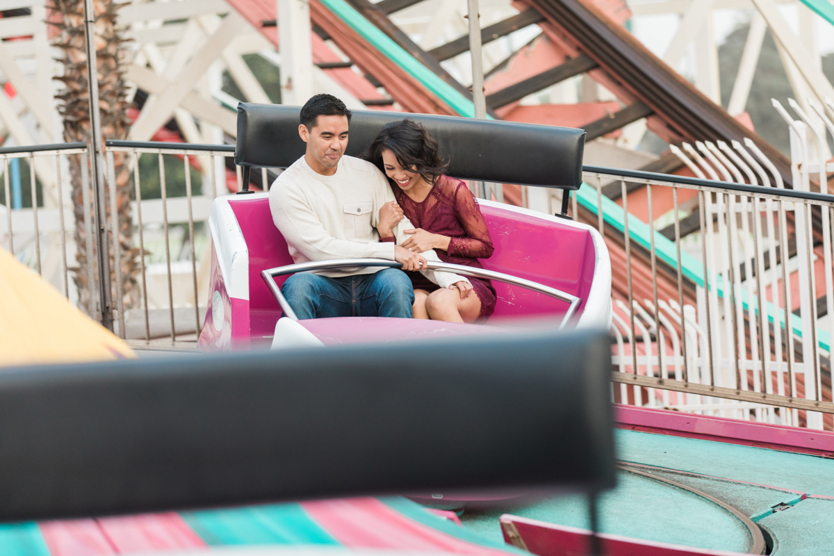 belmont park engagement session san diego couple on twirling ride
