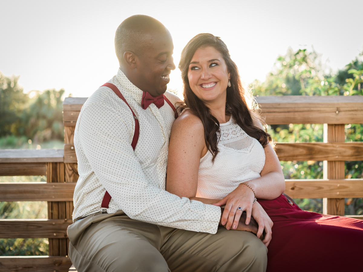 BOCA RATON ENGAGEMENT SESSION COUPLE ON BENCH SMILING