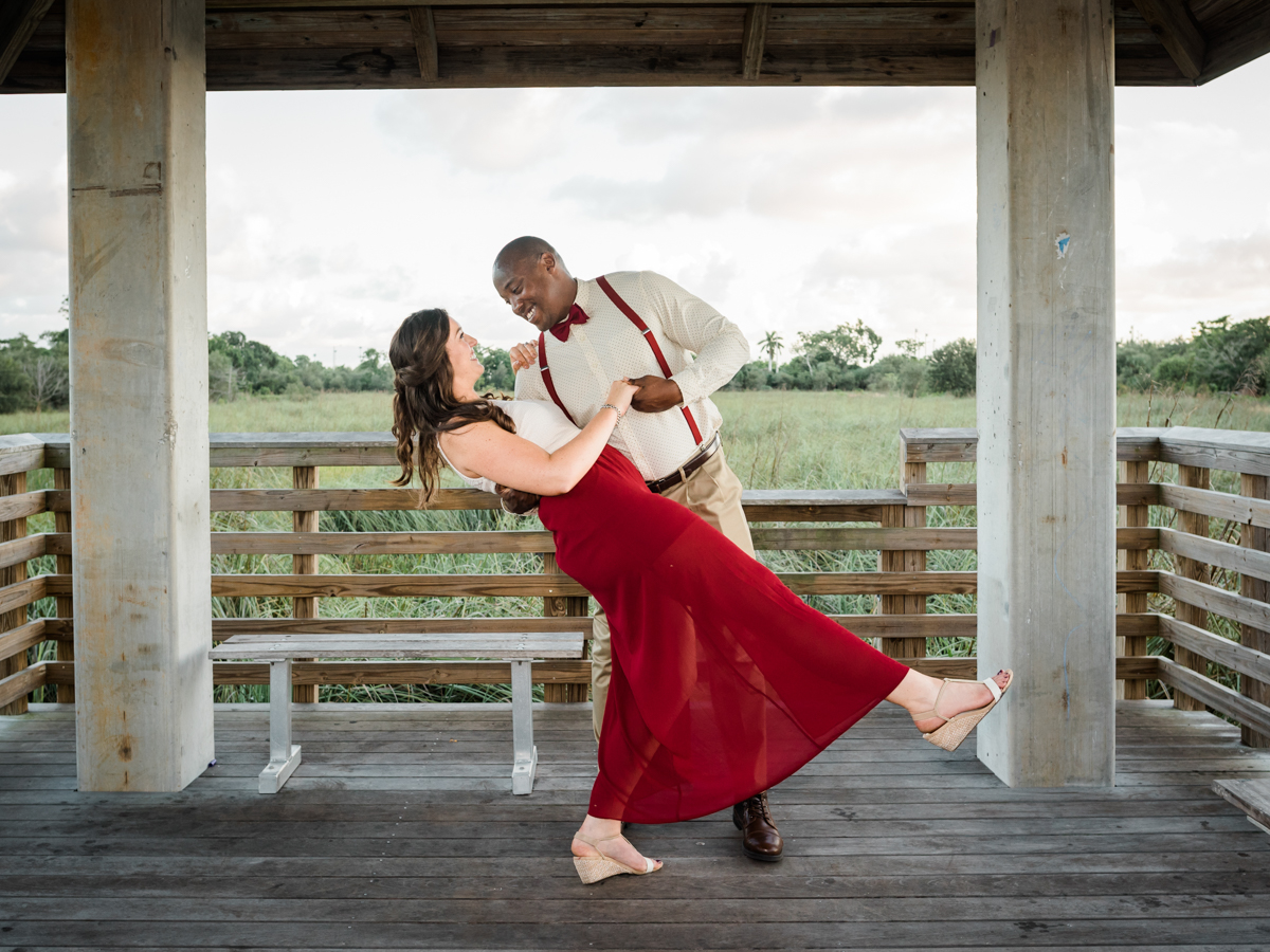 BOCA RATON ENGAGEMENT SESSION COUPLE UNDER GAZEBO, KRIS DIPPING KELSEY IN DANCE POSE