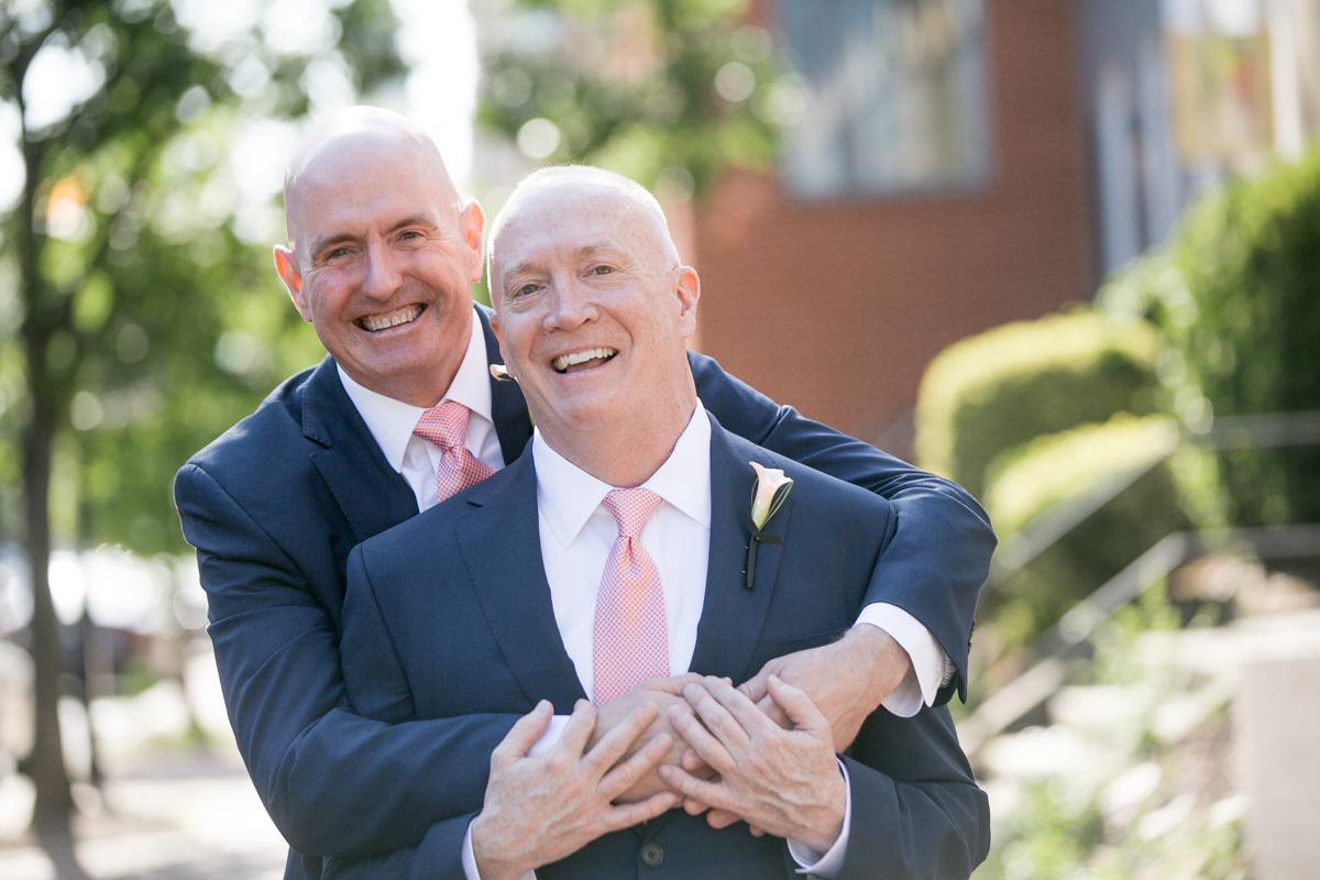 elegant, heartfelt alexandria, va wedding grooms smiling on sidewalk