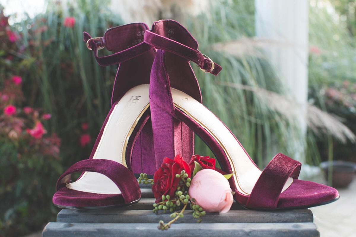 B ohemian Styled Shoot velvet heels on pedestal outside