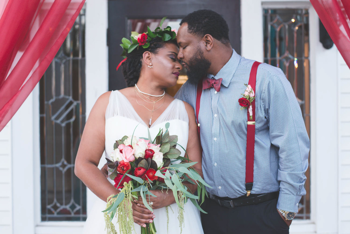 B ohemian Styled Shoot couple under tulle entryway