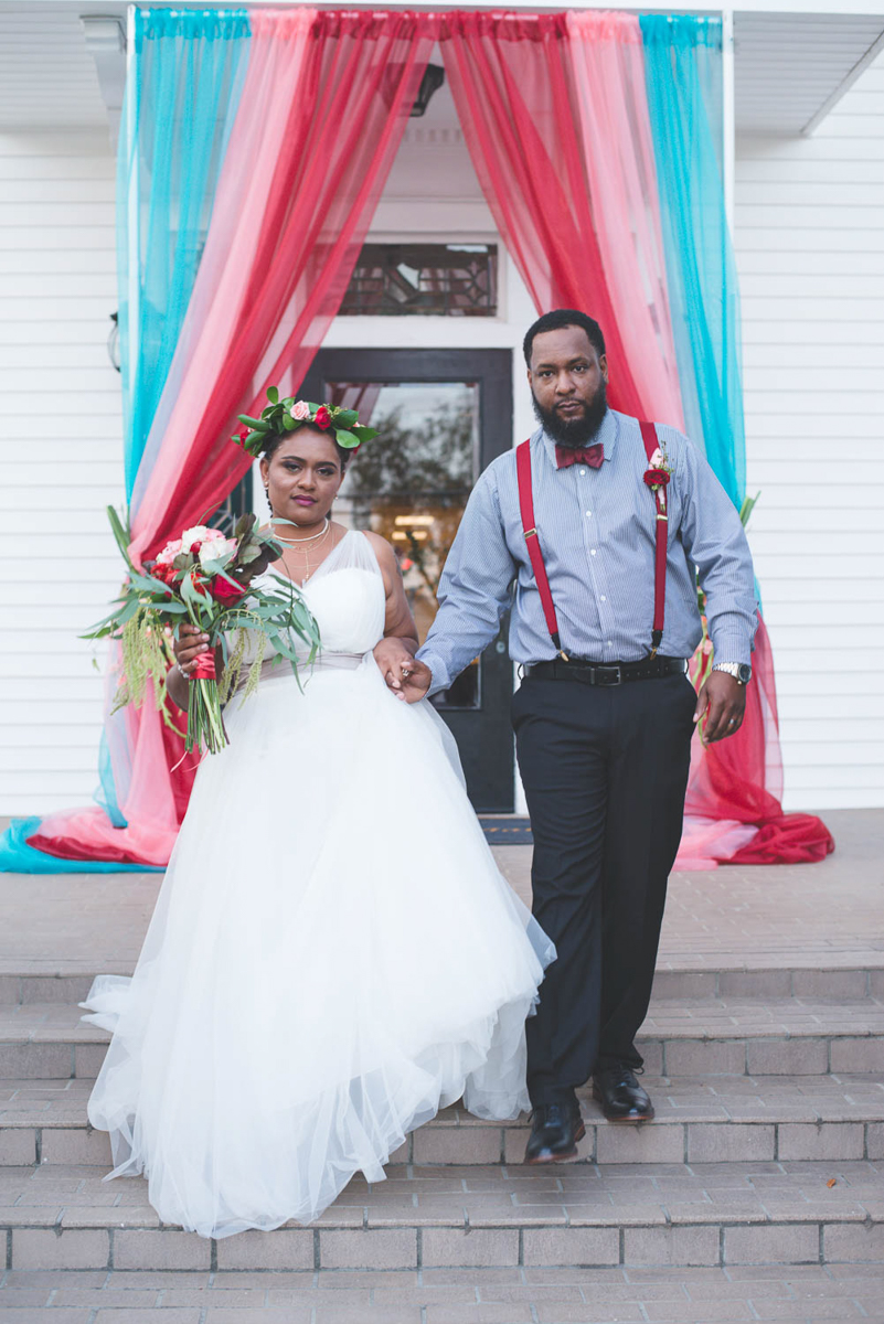 B ohemian Styled Shoot couple walking down brick steps holding hands