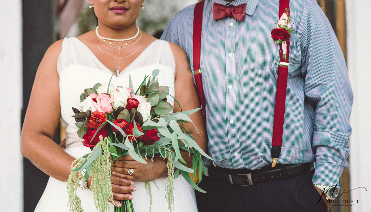B ohemian Styled Shoot couple side by side, bride holding bouquet
