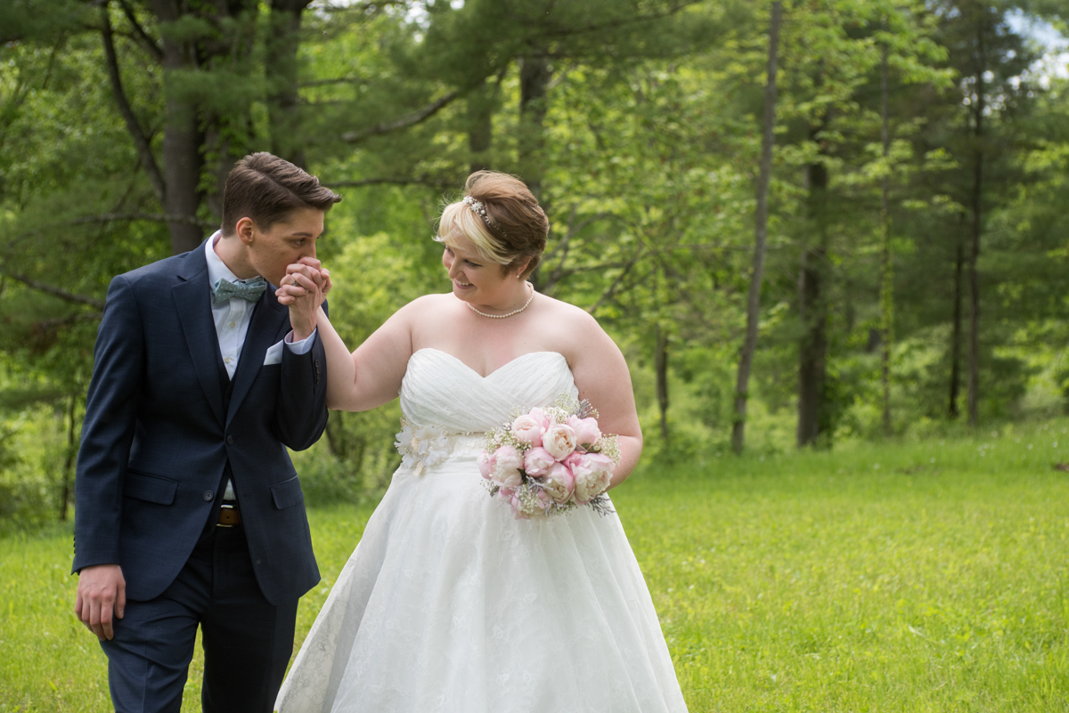 saratoga springs wedding brides in grassy meadow holding hands