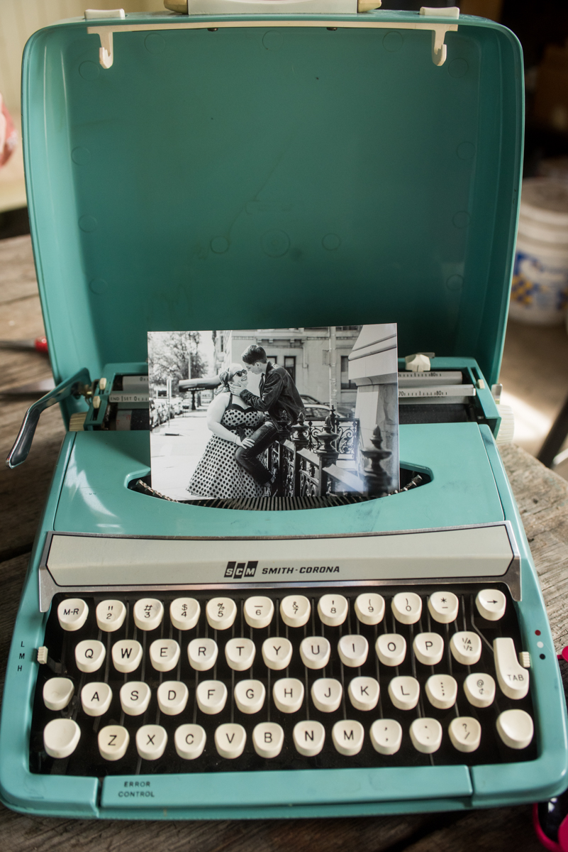 saratoga springs wedding typewriter with picture of brides in paper feed