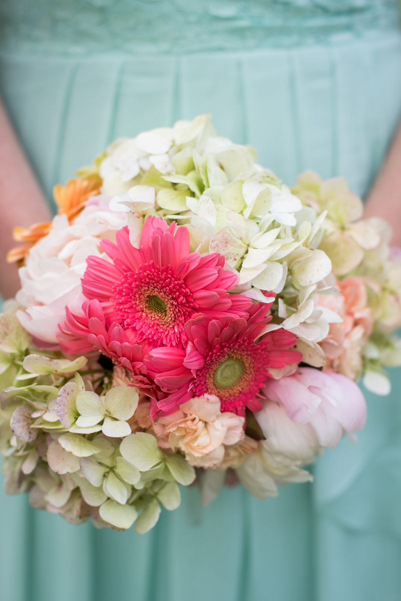 saratoga springs wedding bridesmaid holding bouquet