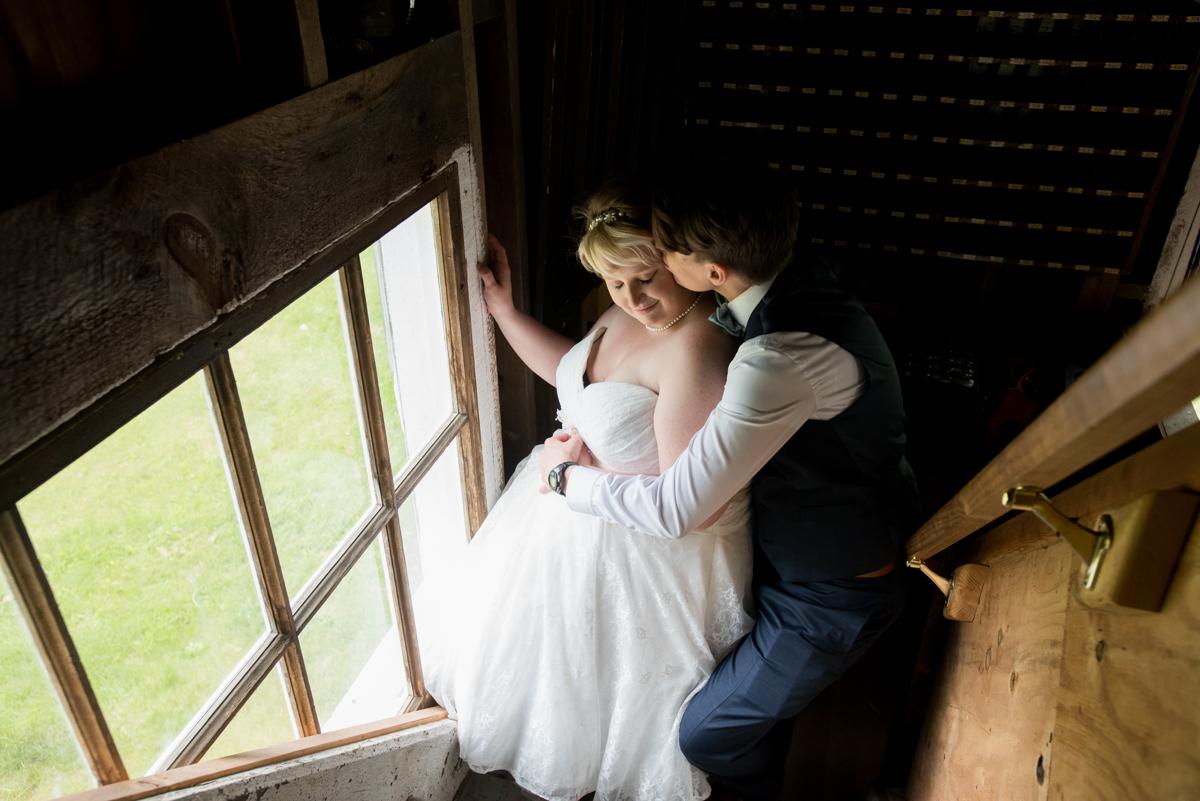 saratoga springs wedding embrace on steps near window