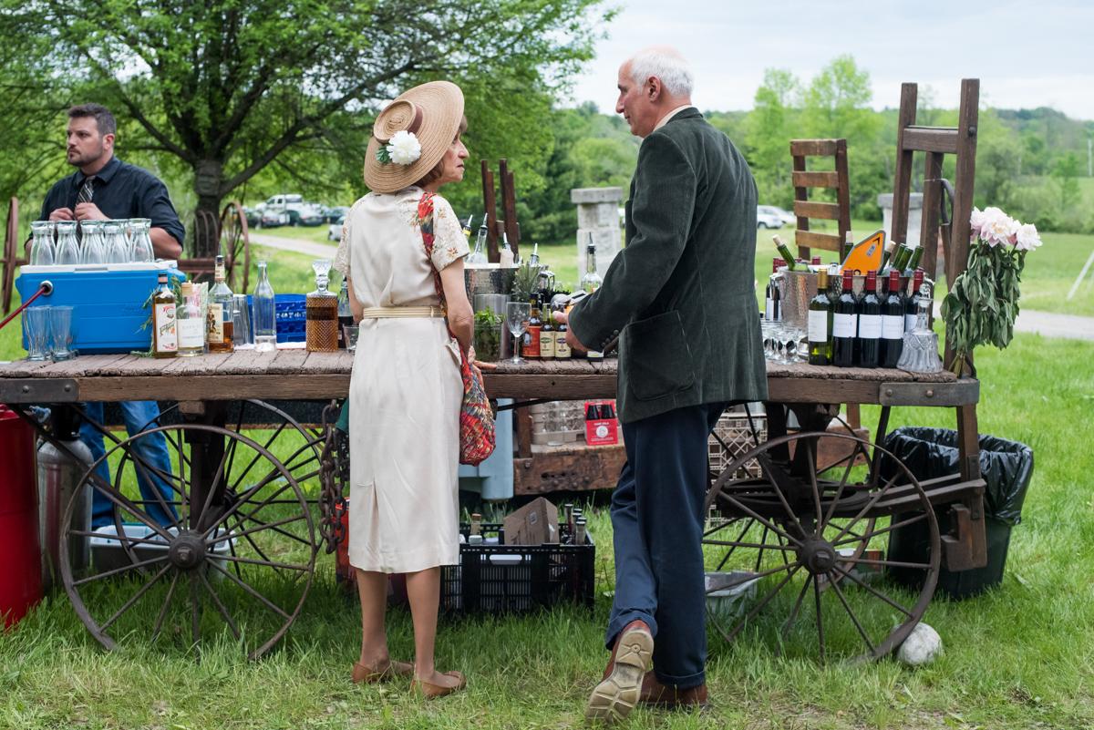 saratoga springs wedding guests at makeshift bar set up on wagon