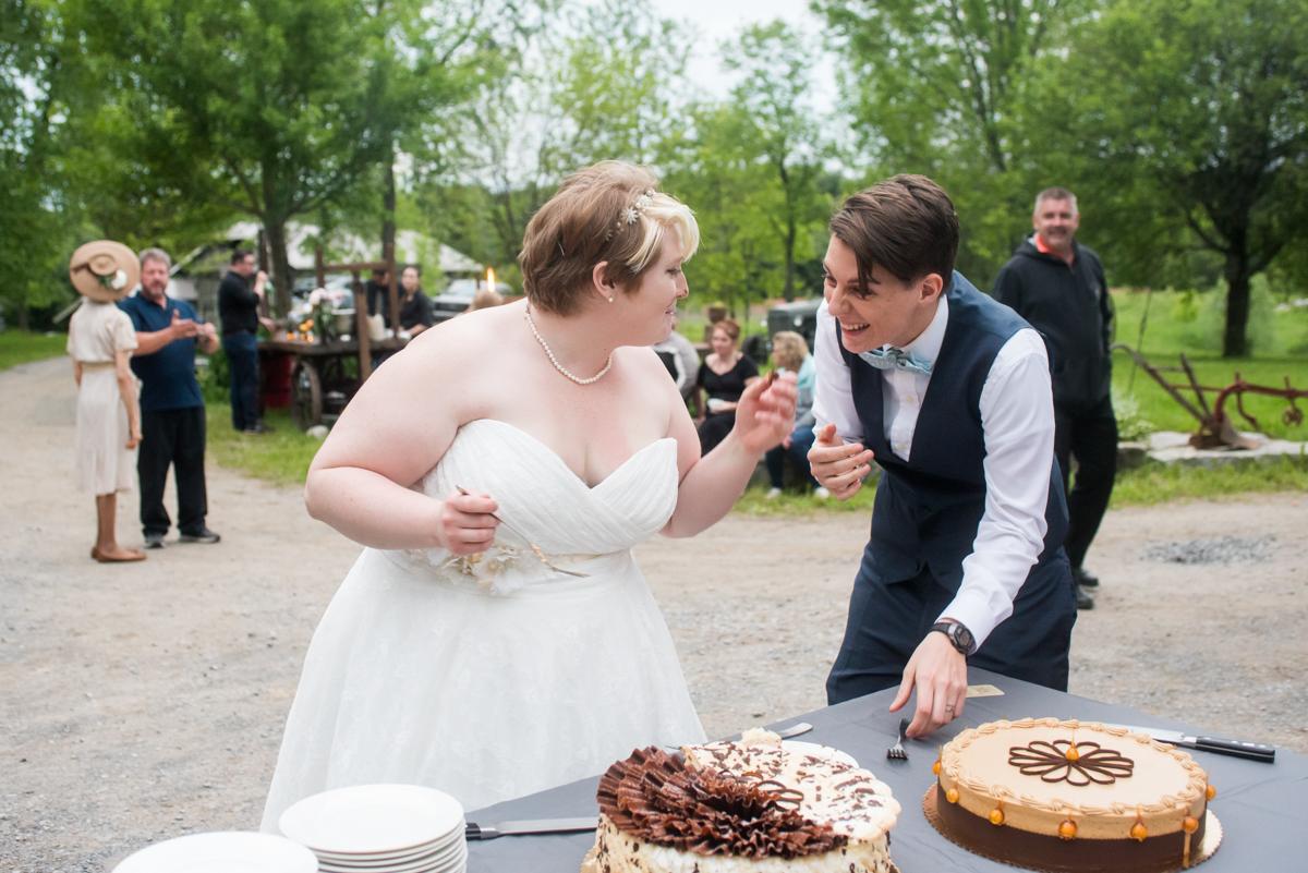 saratoga springs wedding brides laughing at cake table