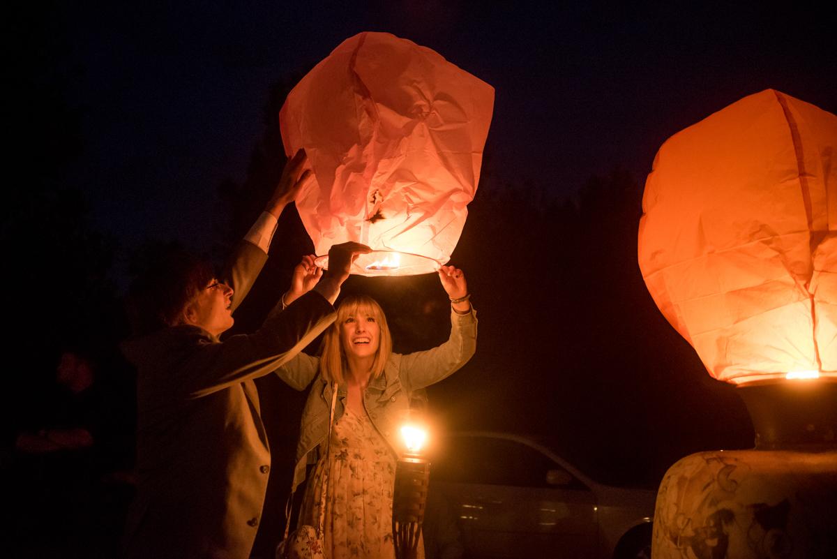 saratoga springs wedding guests preparing paper lanterns