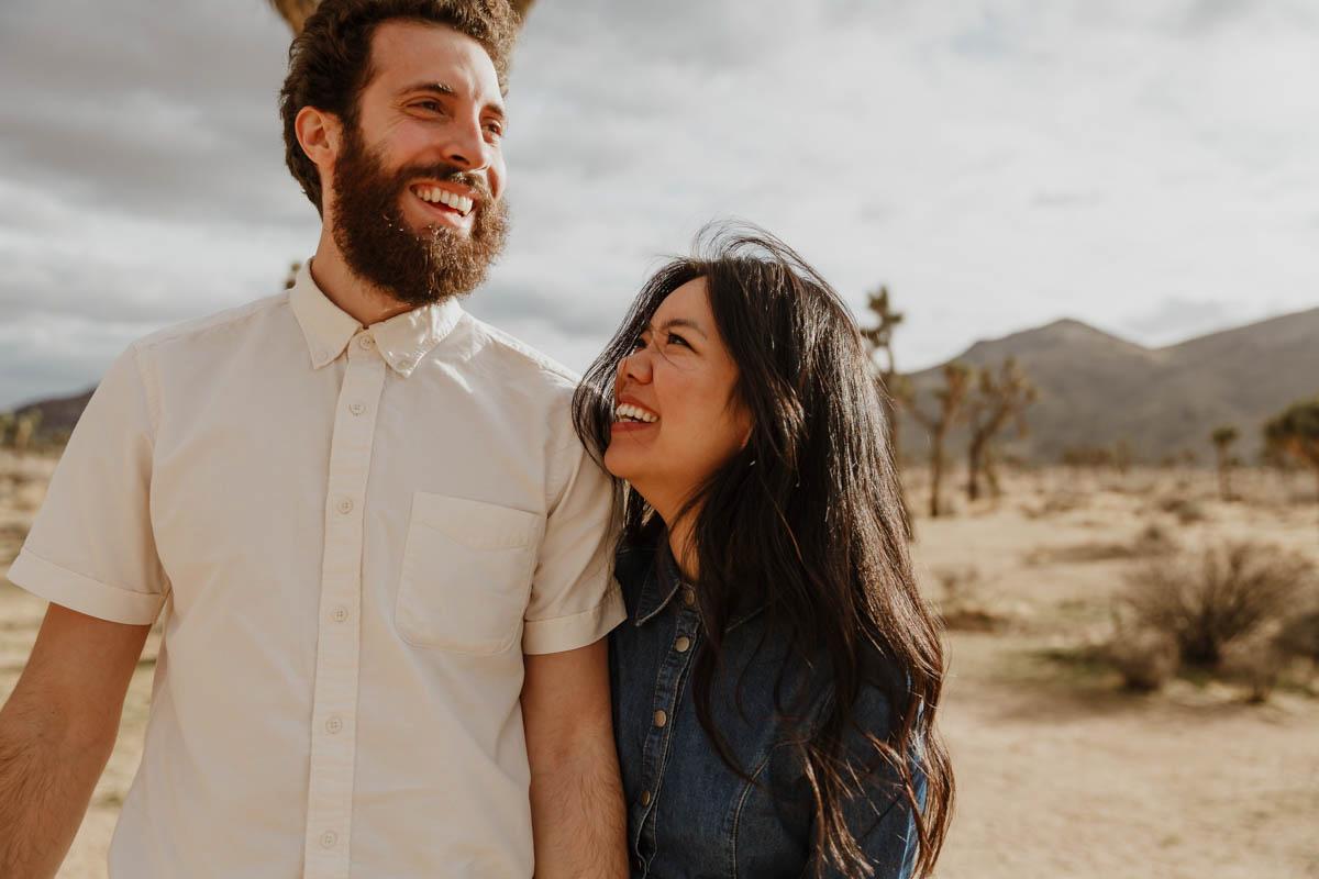 joshua tree california engagement session couple in desert, eda smiling at matt
