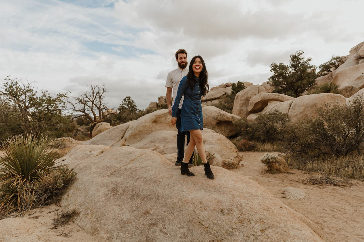 joshua tree california engagement session couple on rock