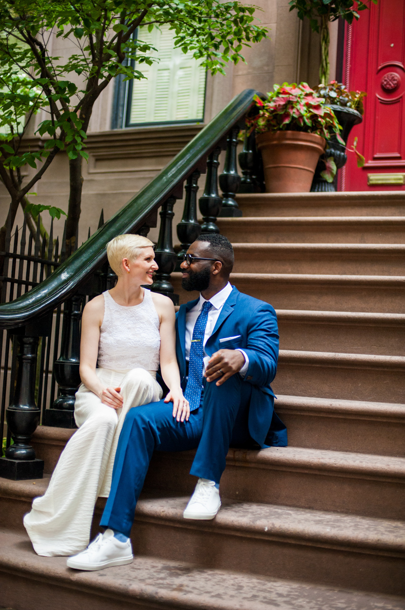 intimate new york elopement couple sitting on steps