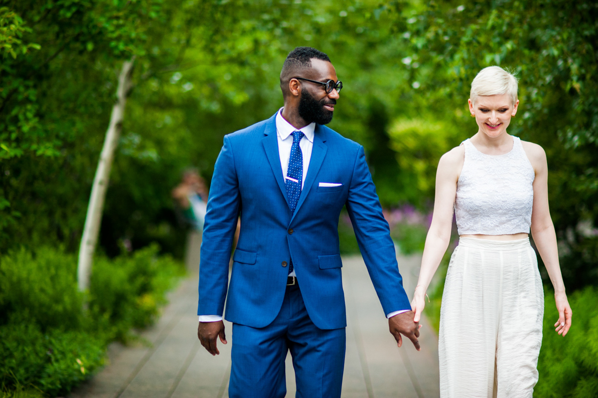 intimate new york elopement holding hands on tree-lined park path