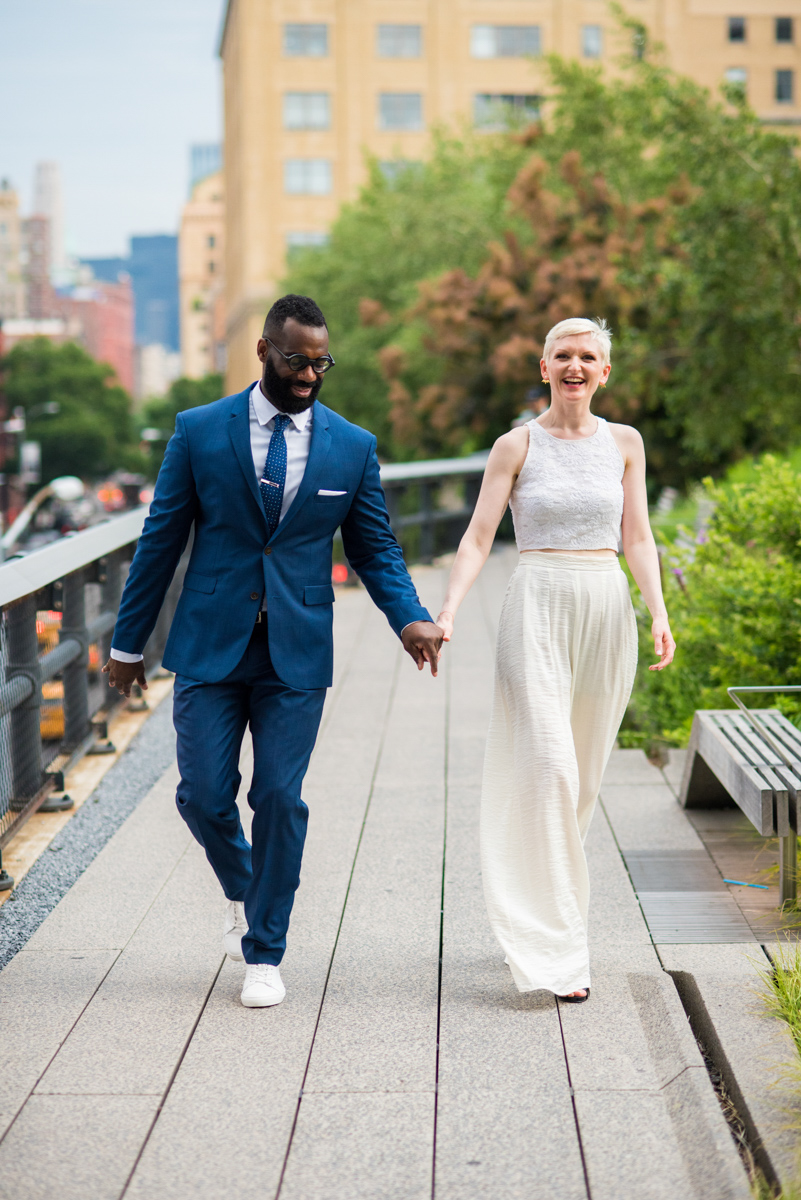 intimate new york elopement couple walking down garden path holding hands