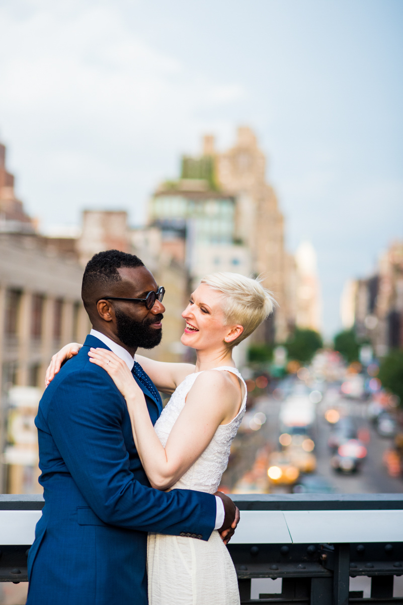intimate new york elopement embrace on bridge above traffic