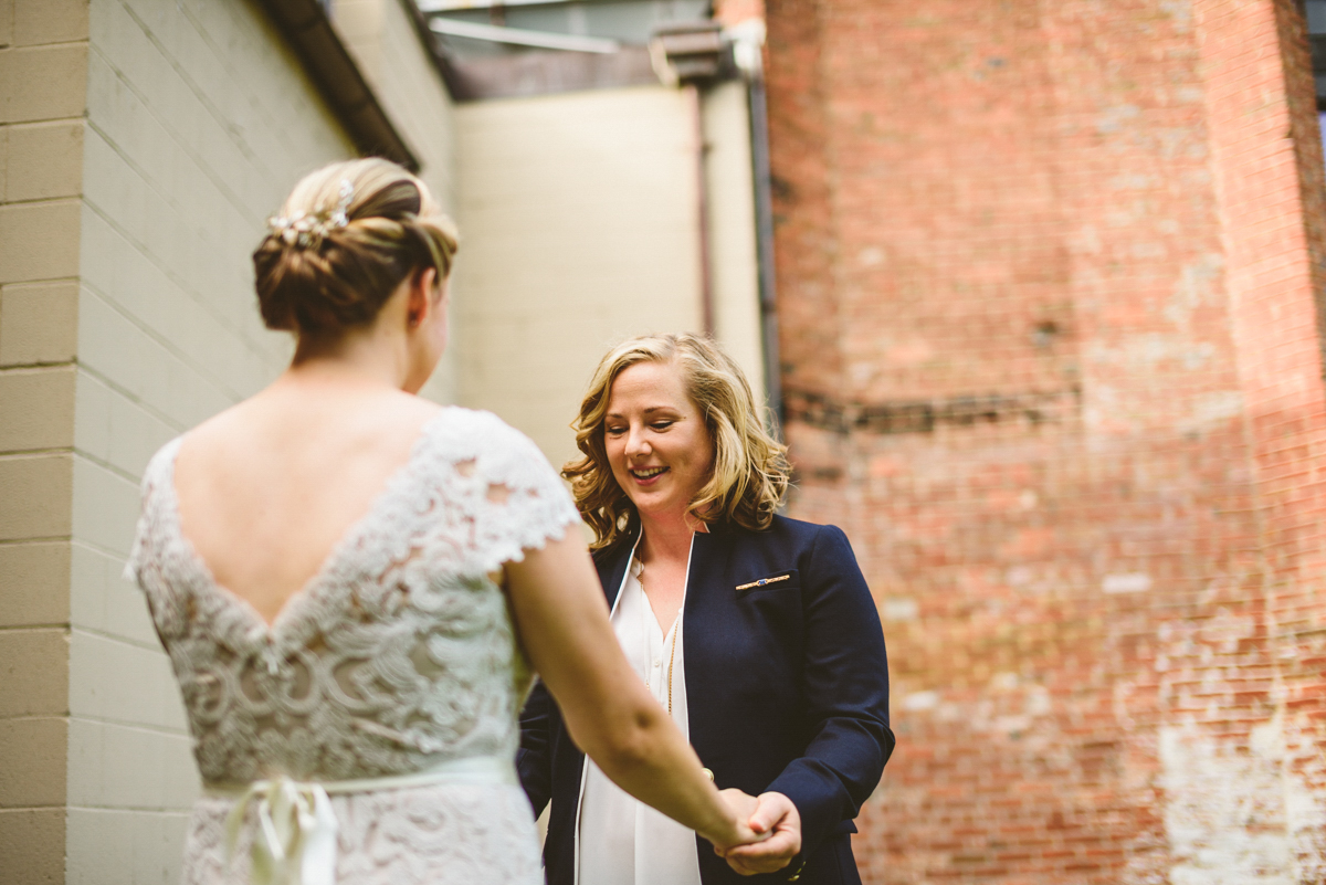 BALTIMORE WEDDING AT MOUNT WASHINGTON MILL DYE HOUSE FIRST LOOK COUPLE HOLDING HANDS