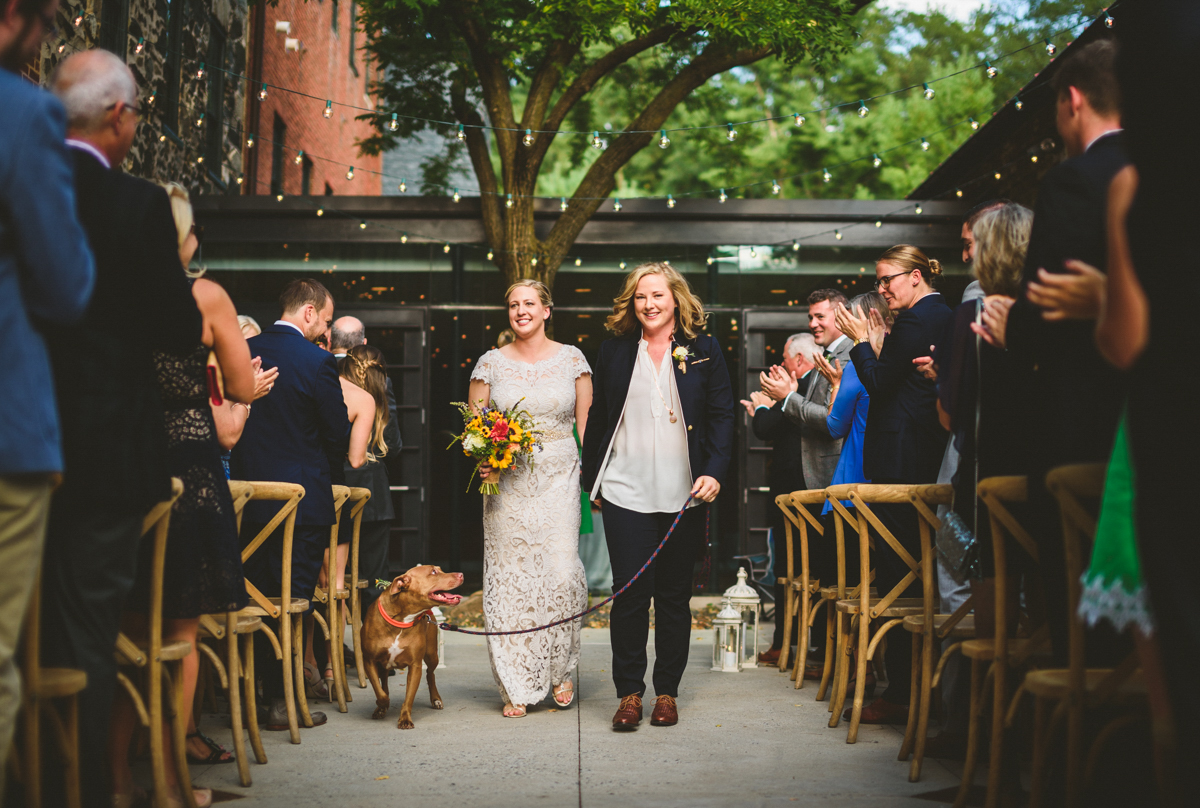 BALTIMORE WEDDING AT MOUNT WASHINGTON MILL DYE HOUSE COUPLE WALKING DOWN AISLE WITH LOVEY, GUESTS CLAPPING