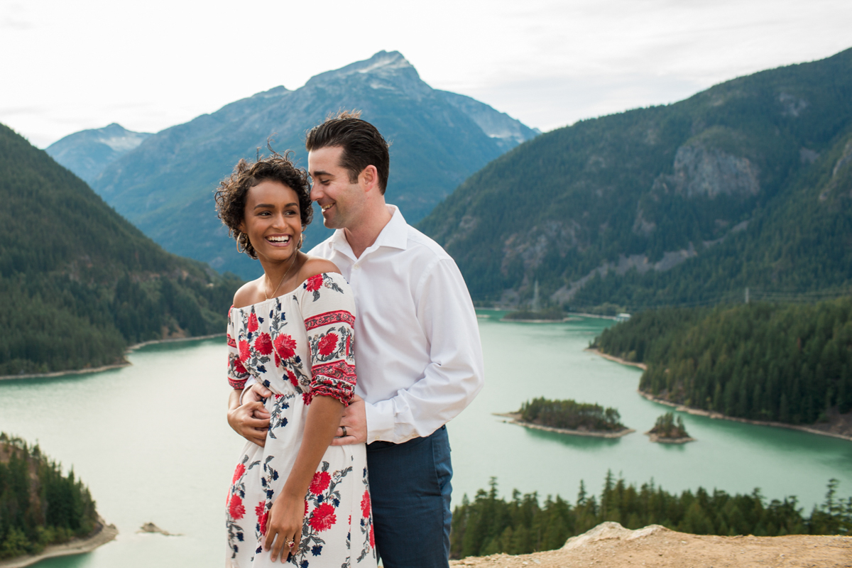Diablo lake engagement session candid overlooking lake and mountains
