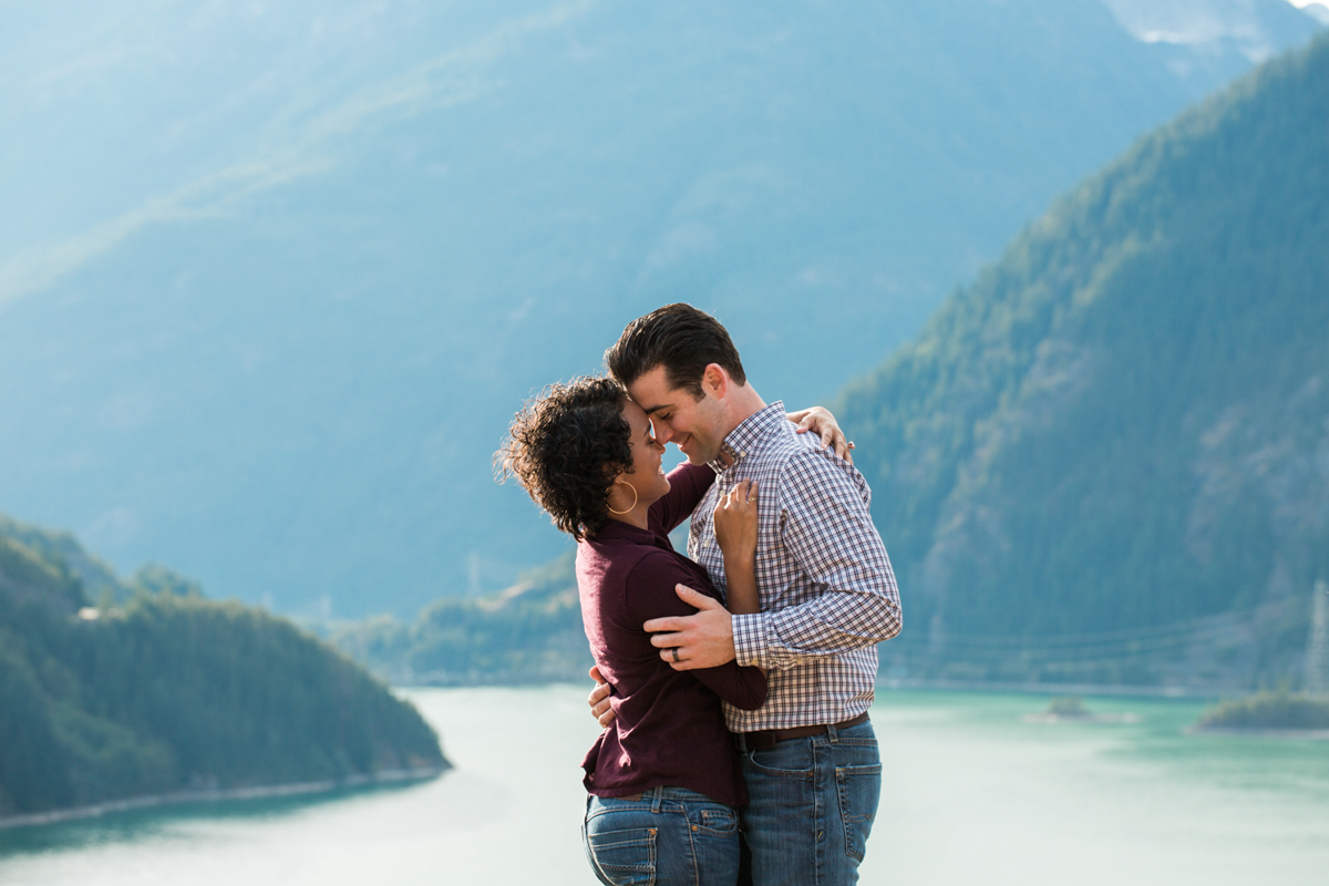Diablo lake engagement session couple embracing